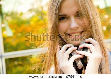 Young, happy beautiful girl with headphones