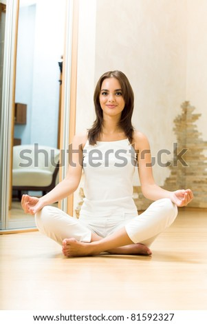 Young happy beautiful woman exercising at home