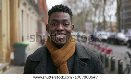 Young happy black African man walking outside. ストックフォト ©