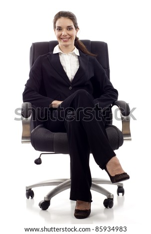 Young happy business woman sitting on a chair isolated on white