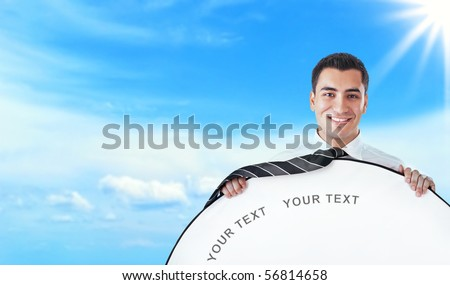 Young happy businessman hold rounded white border, space for your text