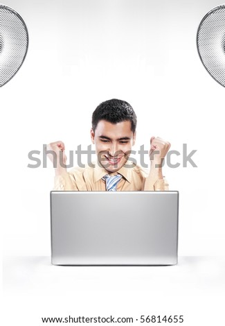 Young happy businessman using laptop, isolated on white