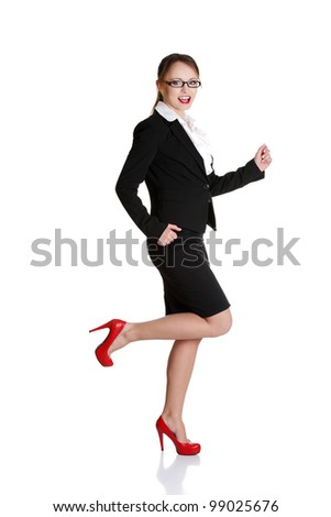Young happy businesswoman in a rush. Isolated on white
