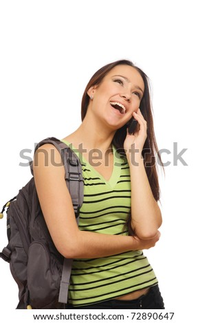 Young happy caucasian woman is calling with a mobile phone