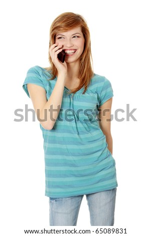 Young happy caucasian woman is calling with a mobile phone isolated on white
