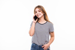 Young happy caucasian woman is calling with a mobile phone isolated on white background