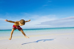 young happy child boy on tropical beach