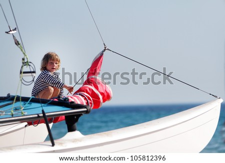 young happy child on board of sea yacht