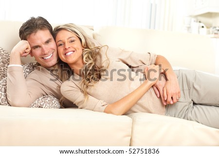 Young happy couple at home