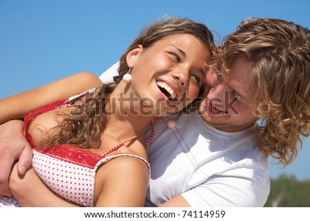 Young happy couple at the beach