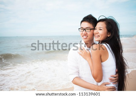 Young happy couple at the seashore