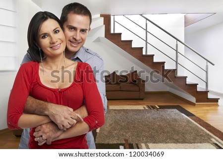 Young happy couple at their new house