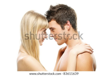Young happy couple: beautiful smiling blonde woman and brunette man looking at each other against white background.