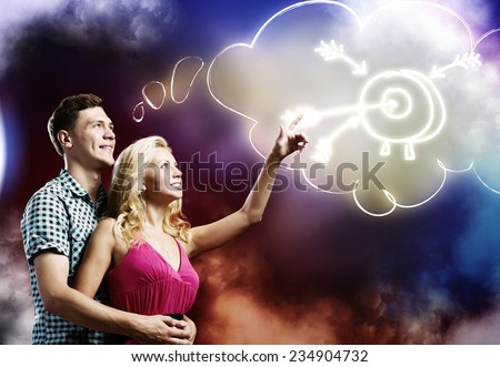 Young happy couple dreaming about future successful life