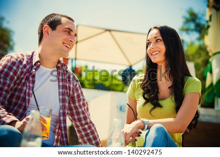 young happy couple drink  refreshments in cafe outdoor summer day - stock photo