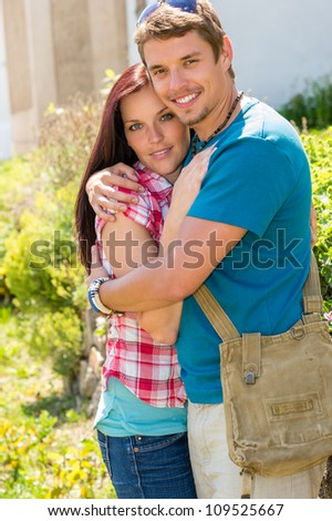 Young happy couple embracing in sunny park smiling pure romance