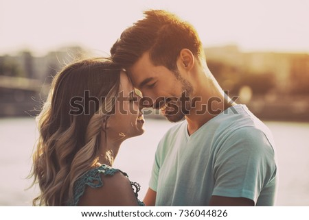 Young happy couple enjoys spending time outdoor together.Happy couple Image is intentionally toned.  #736044826