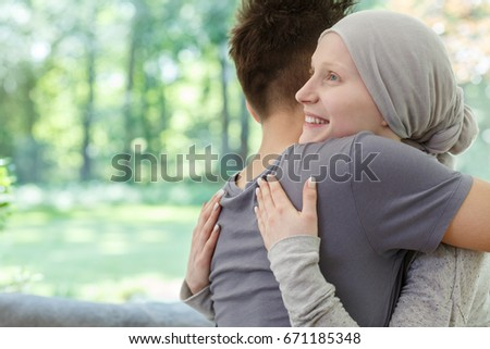 Young happy couple hugging after hearing the good news