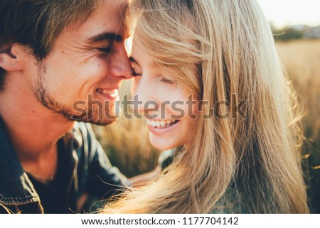 Young happy couple hugging and laughing. Space for text. Close-up. #1177704142