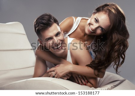 Young happy couple hugging each other  stock photo