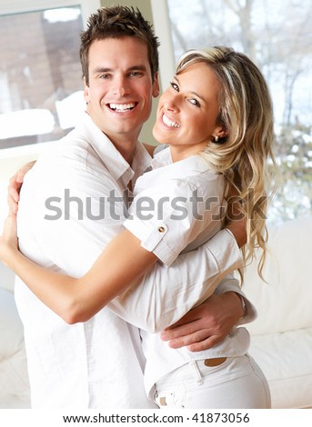 Young happy  couple in love at home