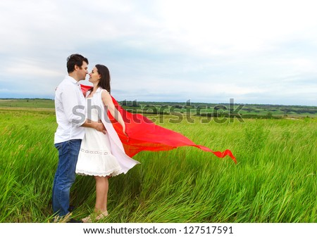 Young happy couple in love in spring day. Outdoors portrait