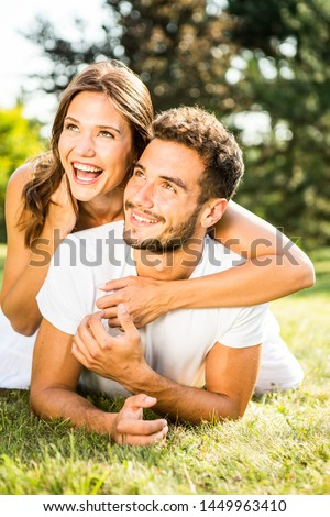 Young Happy Couple in Love in the Nature #1449963410