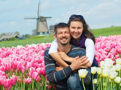 Young happy couple in pink tulip fields from the Netherlands