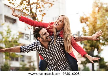 Young happy couple is enjoying city. #493016008