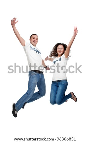 Young happy couple jumping up isolated on white - stock photo