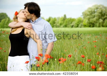 Young happy couple (kissing)