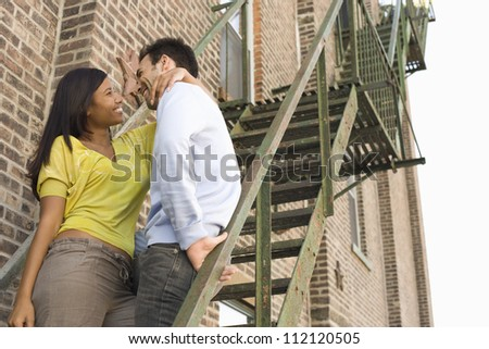 Young happy couple on steps spending time together