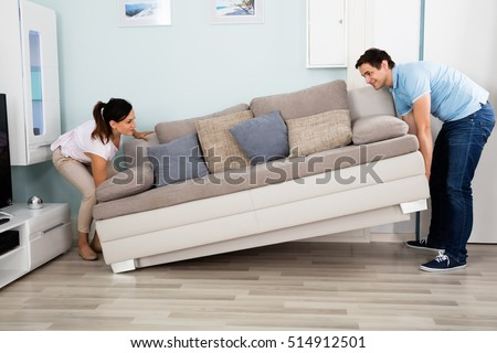 Young Happy Couple Placing Sofa Together In Living Room At Home #514912501