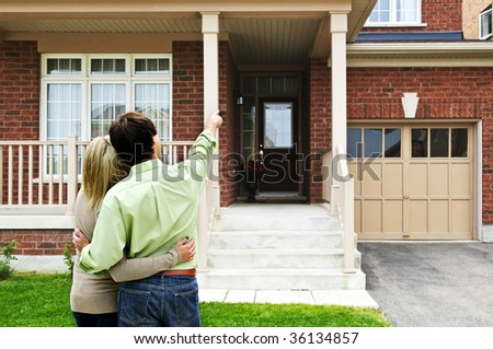 Young happy couple shopping for new home