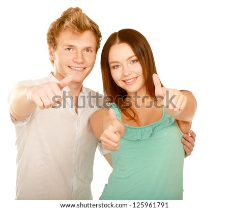 Young happy couple showing ok, isolated on white background