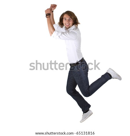 Young happy european man with long hair jumping out of joy