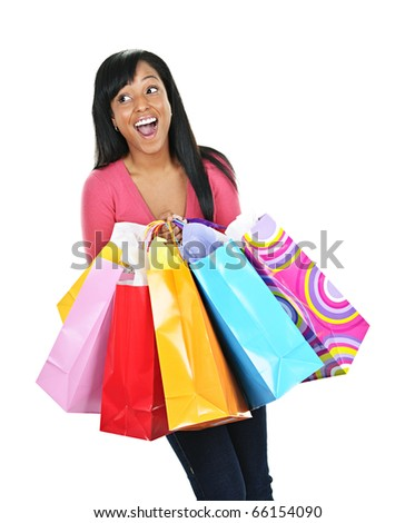 Young happy excited black woman holding shopping bags