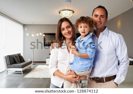 Young happy family at home