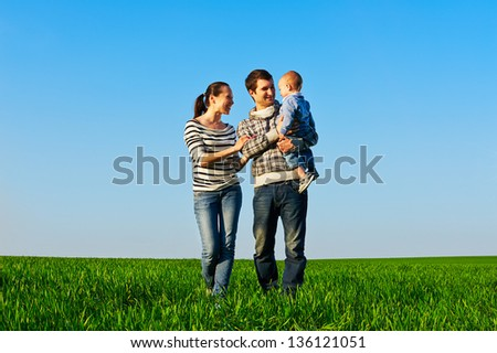 young happy family at outdoors