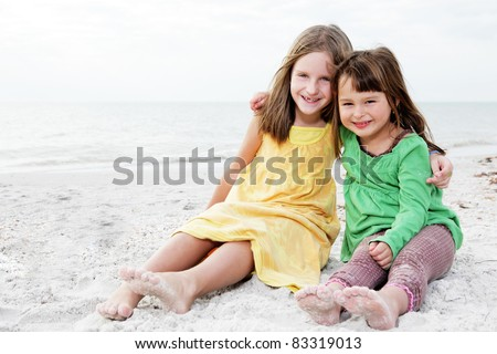 Young happy family enjoy summer day at the beach.