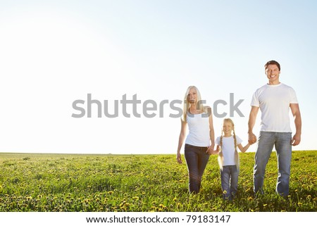 Young happy family in a field