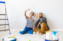 young happy family married couple dreams of renovating  house and planning a design project