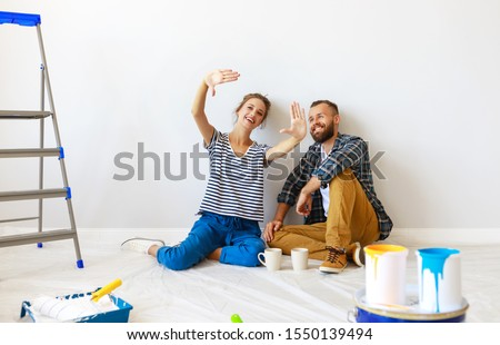 young happy family married couple dreams of renovating  house and planning a design project Foto d'archivio ©