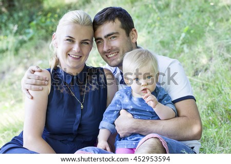 Young happy family the park #452953594