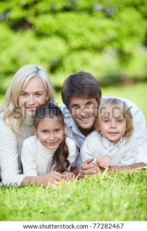 Young happy family with kids in the park