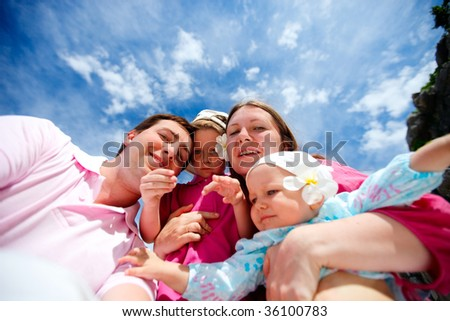 Young happy family with two kids on vacation