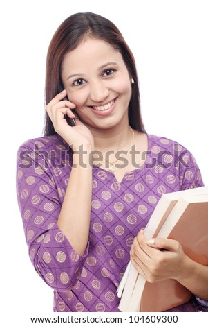Young happy female student talking on cellphone