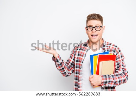 Young happy genious student with great idea pointing