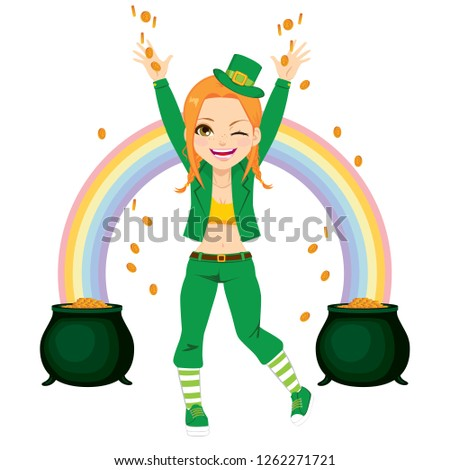Young happy girl dressed with leprechaun costume sharing golden coins money