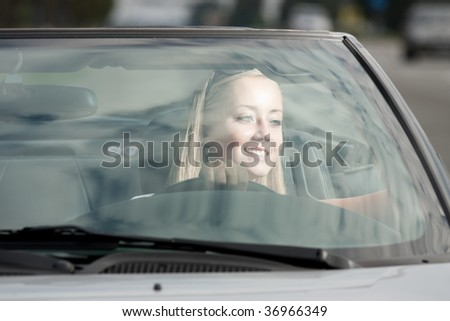 young happy girl driving cabrio car, on sunset light